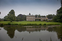 The south front of Hackthorn Hall viewed over a lake in the grounds