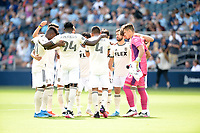 KANSAS CITY, KS - JUNE 26: Los Angeles FC  players in pre game huddle during a game between Los Angeles FC and Sporting Kansas City at Children's Mercy Park on June 26, 2021 in Kansas City, Kansas.