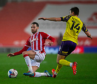 21st November 2020; Bet365 Stadium, Stoke, Staffordshire, England; English Football League Championship Football, Stoke City versus Huddersfield Town; Nick Powell of Stoke City tackles Carel Eiting of Huddersfield Town
