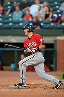 Birmingham Barons catcher Kevan Smith (32) at bat during a game against the Chattanooga Lookouts on April 24, 2014 at AT&T Field in Chattanooga, Tennessee.  Chattanooga defeated Birmingham 5-4.  (Mike Janes/Four Seam Images)