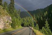 Rainbow over highway, Bitterroot Mountains near Lolo Pass
