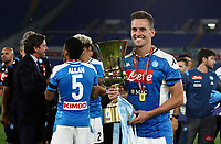 Napoli's Arkadiusz Milik holds the trophy at the end of the Italian Cup football final match between Napoli and Juventus at Rome's Olympic stadium, with closed doors, June 17, 2020. Napoli won 4-2 at the end of a penalty shootout following a scoreless draw.<br /> UPDATE IMAGES PRESS/Isabella Bonotto