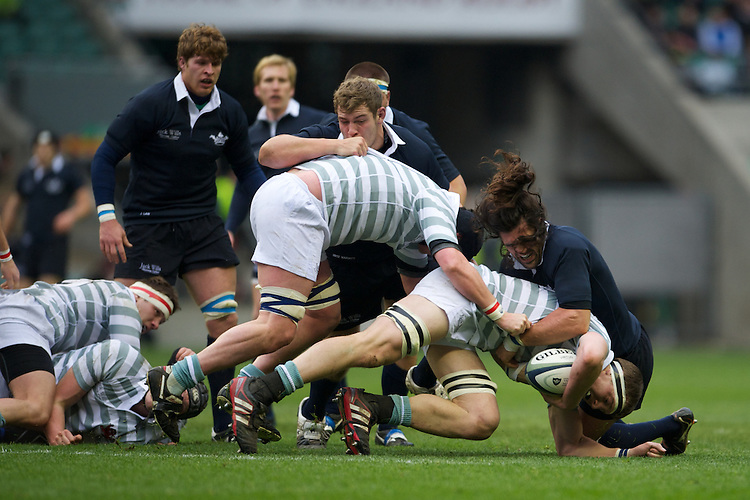 Nate Brakeley of Cambridge University drives forward but is stopped by John Carter of Oxford University during the 131st Varsity Match between Oxford University and Cambridge University at Twickenham on Thursday 06 December 2012 (Photo by Rob Munro)