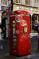 Red phone box and soap bubbles<br /> Scotland May 8th - 19th. Trip across Scotland<br /> Foto Samantha Zucchi Insidefoto