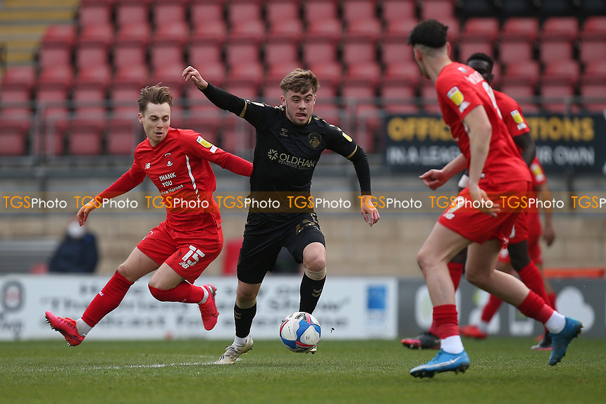 Alfie McCalmont of Oldham Athletic and Dan Kemp of Leyton Orient during Leyton Orient vs Oldham Athletic, Sky Bet EFL League 2 Football at The Breyer Group Stadium on 27th March 2021