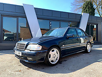 BNPS.co.uk (01202 558833)<br /> Pic: HampsonAuctions/BNPS<br /> <br /> Pictured: 1996 Mercedes-Benz C36 AMG.<br /> <br /> Since the 1990s, Geoff Barlow, 46, has collected dozens of classic cars from an Escort Mexico replica to several types of Transit, Cortina, and Sierra.<br /> <br /> However, he still regrets selling the first car which inspired his passion, a 1980 Escort Mark 2 he bought from his sister in 1992.  <br /> <br /> Geoff's fascination with Fords gathered pace in the last decade and he 'lost control,' buying as many Fords as he came across and saving them from disrepair.