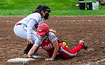 WOLCOTT, CT 051021JS25—Wolcott's Katie Cosmos (7) dives back safely to third base in front of the tag by Torrington's Madison McLaughlin (19) during their  game Monday at Wolcott High School. Jim Shannon Republican American