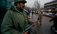 Srinagar / Kashmir / India.Indian Army soldier patrolling a crossroad in downtown Srinagar. The mountainous region of Kashmir has been a flashpoint between India and Pakistan for more than 60 years..Photo Livio Senigalliesi.