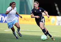 Cat Whitehill #4 of the Washington Freedom makes her move on Chioma Igwe #12 of the Chicago Red Stars during a WPS match at RFK stadium on June 13 2009 in Washington D.C. The game ended in a 0-0 tie.