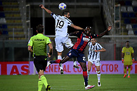 Leonardo Bonucci of Juventus FC and Simy of FC Crotone compete for the ball during the Serie A football match between FC Crotone and Juventus FC at stadio Ezio Scida in Crotone (Italy), October 17th, 2020. Photo Federico Tardito / Insidefoto