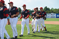 Batavia Muckdogs Samuel Castro (25) gives the peace sign after a game against the Staten Island Yankees on August 28, 2016 at Dwyer Stadium in Batavia, New York.  Batavia defeated Staten Island 6-0. Also show Joel Effertz (56), Reilly Hovis (28), Eric Gutierrez (43), and Mike Garzillo (11).  (Mike Janes/Four Seam Images)