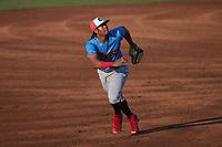 Guerreros de Fayetteville third baseman Yeuris Ramirez (20) on defense against the Rapidos de Kannapolis at Atrium Health Ballpark on June 24, 2021 in Kannapolis, North Carolina. (Brian Westerholt/Four Seam Images)