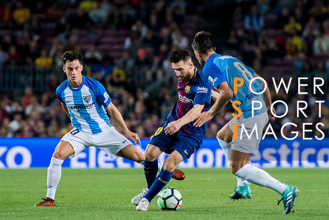 Lionel Andres Messi (c) of FC Barcelona fights for the ball with Juan Pablo Anor Acosta, Juanpi (l) and Adrian Gonzalez Morales of Malaga CF during the La Liga 2017-18 match between FC Barcelona and Malaga CF at Camp Nou on 21 October 2017 in Barcelona, Spain. Photo by Vicens Gimenez / Power Sport Images