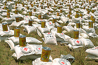 Food aid is laid out for distribution to refugees at the Swabi Refugee camp. The camp is run by Red Cross/Red Crescent (ICRC), and currently houses around 18,000 refugees. The Pakistani government began an offensive against the Taliban in the Swat Valley in April 2009, which led to a major humanitarian crisis. Up to two million civilians were estimated to have been displaced by the fighting.