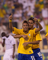 Brazil forward Neymar (11) celebrates his goal with Brazil midfielder Paulo Henrique Ganso (10). Brazil  defeated the US men's national team, 2-0, in a friendly at Meadowlands Stadium on August 10, 2010.