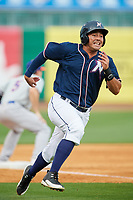 Northwest Arkansas Naturals designated hitter Samir Duenez (9) runs home during a game against the Midland RockHounds on May 27, 2017 at Arvest Ballpark in Springdale, Arkansas.  NW Arkansas defeated Midland 3-2.  (Mike Janes/Four Seam Images)