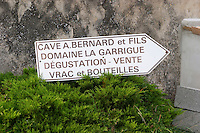 Sign to Cave Winecellar A Bernard Domaine la Garrigue. Tasting bottle sale and in bulk.
