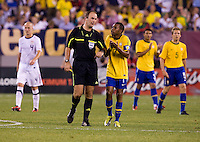 Robinho (7) of Brazil pleads his case to referee Silviu Petrescu during an international friendly at the New Meadowlands Stadium in East Rutherford, NJ. Brazil defeated the USMNT, 2-0.