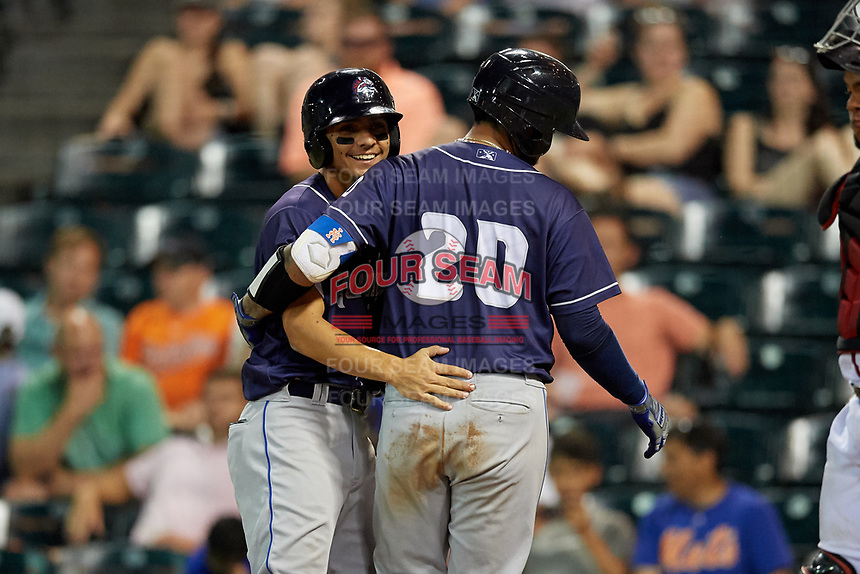 Binghamton Rumble Ponies Andres Gimenez (left) congratulates Ali Sanchez (20) after a home run during an Eastern League game against the Richmond Flying Squirrels on May 29, 2019 at The Diamond in Richmond, Virginia.  Binghamton defeated Richmond 9-5 in ten innings.  (Mike Janes/Four Seam Images)