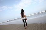 Ha walks on the beach near Hoa's Place guesthouse south of Da Nang, Vietnam. Dec. 25, 2012.