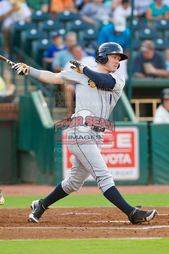 Aaron Gates (9) of the Charleston RiverDogs follows through on his swing against the Greensboro Grasshoppers at NewBridge Bank Park on July 17, 2013 in Greensboro, North Carolina.  The Grasshoppers defeated the RiverDogs 4-3.  (Brian Westerholt/Four Seam Images)