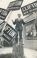 Taking the politician's traditional chore of stumping the hustings quite literally, Roy Clifton, the New Democratic Party candidate in York Centre, stands on the stump of a dead elm in front of his campaign headquarters in Richmond Hill.