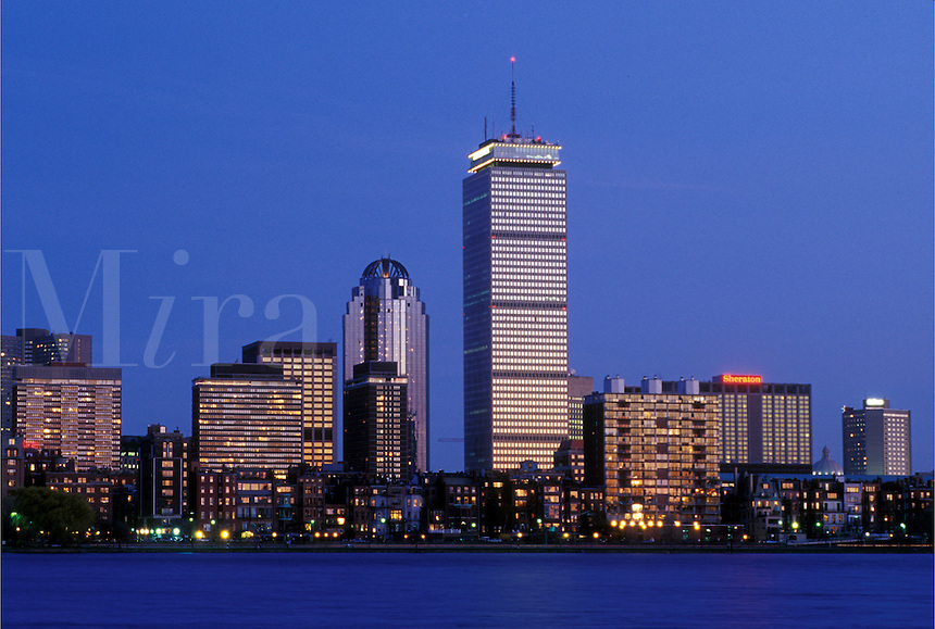Boston, skyline, MA, Massachusetts, The Prudential Tower and skyline of downtown Boston along the Charles River in the evening.