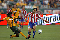 Los Angeles Galaxy's Ugo Ihemelu kicks the ball away from Chivas USA  Thiago Martins in the first half at the Home Depot Center in Carson, CA on Saturday, July 16, 2005..(Matt A. Brown/ISI)