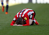 17th April 2021; Brentford Community Stadium, London, England; English Football League Championship Football, Brentford FC versus Millwall; Mathias Jensen of Brentford injured on the pitch after taking a knock