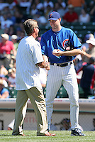 Chicago Cubs pitcher Sean Marshall shakes hands with Bill Buckner after the ceremonial first pitch from Bill Buckner before a game against the New York Mets at Wrigley Field on July 15, 2006 in Chicago, Illinois.  (Mike Janes/Four Seam Images)