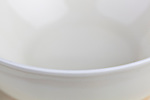 Empty white china cup close up.