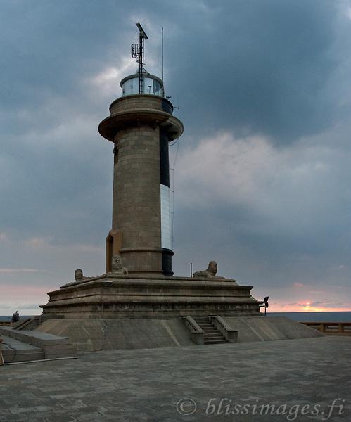 Sun sets with storm clouds at Galbokka Point lighthouse, Navy Headquarters, Colombo, Sri Lanka
