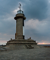 Sun sets with storm clouds at Galbokka Point lighthouse, Navy Headquarters, Colombo, Sri Lanka