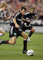 9 April 2005.   DC United's Ben Olsen (14) passes the ball to a sprinting Jaime Moreno (99) while defender by Jim Curtin (5) of Chicago at RFK Stadium in Washington, DC.