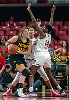 COLLEGE PARK, MD - FEBRUARY 13: Diamond Miller #14 of Maryland and Shakira Austin #1 of Maryland block Monika Czinano #25 during a game between Iowa and Maryland at Xfinity Center on February 13, 2020 in College Park, Maryland.