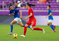 ORLANDO, FL - FEBRUARY 24: Jessie Fleming #17 of Canada dribbles during a game between Brazil and Canada at Exploria Stadium on February 24, 2021 in Orlando, Florida.