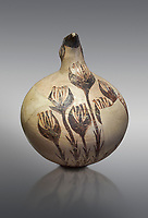 Beak spouted jug decorated with flowering crocus. Early Cycladic I (1650-1550 BC) , Phylakopi, Melos. National Archaeological Museum Athens. Cat No 5769.  Grey background.<br /> <br /> <br /> During this Cycladic period the pottery designs were heavily influenced by Cretean minoan with pottery like this using floral patterns.