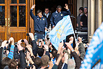 © Joel Goodman - 07973 332324  . 23/05/2011 . Manchester, UK . Carlos Tevez (left) & Kaya Torre (right) step out from Manchester Town Hall ahead of the parade . Tens of thousands of fans line the streets of Manchester as Manchester City Football Club hold an open-topped bus parade through the city. The team are celebrating winning the FA Cup, their first trophy in 35 years, and for qualifying for next season's Champions League . Photo credit: Joel Goodman