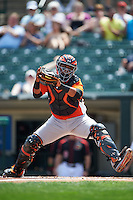 Norfolk Tides catcher Rossmel Perez (23) attempting to tag a runner at home during a game against the Rochester Red Wings on May 3, 2015 at Frontier Field in Rochester, New York.  Rochester defeated Norfolk 7-3.  (Mike Janes/Four Seam Images)