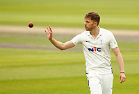 28th May 2021; Emirates Old Trafford, Manchester, Lancashire, England; County Championship Cricket, Lancashire versus Yorkshire, Day 2; Yorkshire bowler Ben Coad receives the ball return
