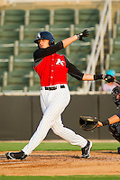 Trayce Thompson #24 of the Kannapolis Intimidators follows through on his swing against the Asheville Tourists at Fieldcrest Cannon Stadium on July 28, 2011 in Kannapolis, North Carolina.  The Intimidators defeated the Tourists 2-1 in 10 innings.   (Brian Westerholt / Four Seam Images)