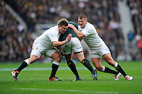 David Wilson and Dylan Hartley of England stop the progress of Adriaan Strauss of South Africa during the QBE International match between England and South Africa at Twickenham Stadium on Saturday 15th November 2014 (Photo by Rob Munro)
