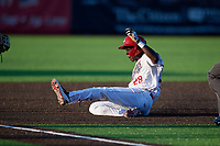 Auburn Doubledays Eric Senior (28) slides safely into third base during a NY-Penn League game against the West Virginia Black Bears on August 23, 2019 at Falcon Park in Auburn, New York.  West Virginia defeated Auburn 8-1, the first game of a doubleheader.  (Mike Janes/Four Seam Images)