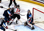 December 14, 2019:  Alex Cavallini [33] makes one of her 31 saves as team USA defeated Canada 4-1. The feisty opening game of a five-match series took place at the XL Center in Hartford, Connecticut. Heary/Eclipse Sportswire/CSM