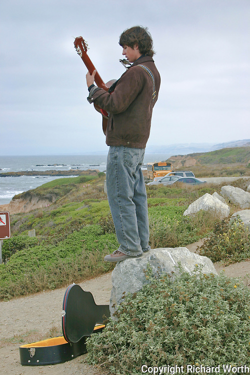"""Modern day minstrel, 18-year-old Hudson McCarty of Arizona, spent Labor Day perched  on a rock in a Pescadero State Beach parking lot south of Half Moon Bay, strumming his guitar and playing his harmonica, hoping to fill his open guitar case with change and perhaps a few bills.  According to Mr. McCarty, after five days of looking he's been unable to find a job in Half Moon Bay and needs gas money.  """"Yesterday,"""" he said, """"I didn't make anything.  But today. . ."""" he peered into the velvet-lined guitar case and the change inside, """"Today I made 43-cents.""""   .""""The cold weather, """" he added, """"makes playing really hard.""""  San Leandro Times 9-7-2006"""