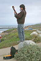 "Modern day minstrel, 18-year-old Hudson McCarty of Arizona, spent Labor Day perched  on a rock in a Pescadero State Beach parking lot south of Half Moon Bay, strumming his guitar and playing his harmonica, hoping to fill his open guitar case with change and perhaps a few bills.  According to Mr. McCarty, after five days of looking he's been unable to find a job in Half Moon Bay and needs gas money.  ""Yesterday,"" he said, ""I didn't make anything.  But today. . ."" he peered into the velvet-lined guitar case and the change inside, ""Today I made 43-cents.""   .""The cold weather, "" he added, ""makes playing really hard.""  San Leandro Times 9-7-2006"