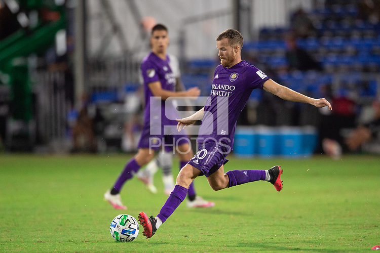 LAKE BUENA VISTA, FL - JULY 25: Oriol Rosell #20 of Orlando City SC kicks the ball during a game between Montreal Impact and Orlando City SC at ESPN Wide World of Sports on July 25, 2020 in Lake Buena Vista, Florida.