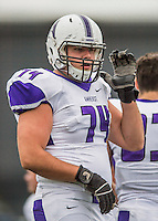 8 October 2016: Amherst College Purple & White Offensive Lineman Mitch Arthur, a Junior from Old Tappan, NJ, is attentive to coaching on the sidelines during a game against the Middlebury College Panthers at Alumni Stadium in Middlebury, Vermont. The Panthers edged out the Purple & While 27-26. Mandatory Credit: Ed Wolfstein Photo *** RAW (NEF) Image File Available ***
