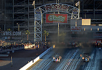 Oct. 27, 2012; Las Vegas, NV, USA: NHRA top fuel driver Doug Kalitta (left) races alongside Bob Vandergriff Jr during qualifying for the Big O Tires Nationals at The Strip in Las Vegas. Mandatory Credit: Mark J. Rebilas-