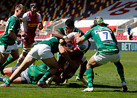 24th April 2021; Brentford Community Stadium, London, England; Gallagher Premiership Rugby, London Irish versus Harlequins; Matt Cornish, Blair Cowan and Albert Tuisue of London Irish prevent Joe Marchant of Harlequins from scoring a try